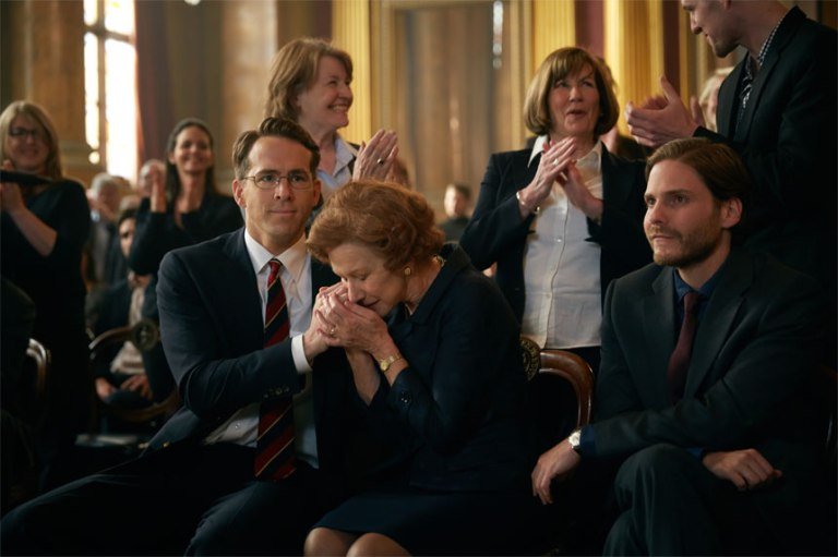 (L-R) RYAN REYNOLDS, HELEN MIRREN, and DANIEL BRUHL star in WOMAN IN GOLD