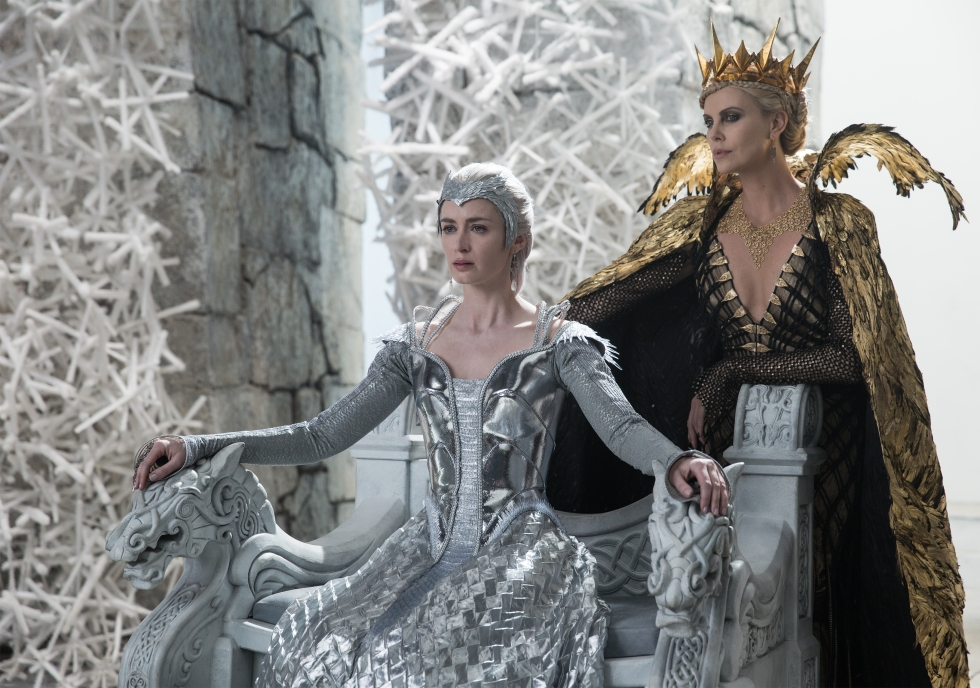 """In this image released by Universal Pictures, Emily Blunt, left, and Charlize Theron appear in a scene from """"Huntsman: Winter's War."""" (Giles Keyte/Universal Pictures via AP)"""